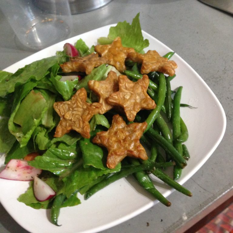 Photo of Tempeh Tantrum stars and cooked greens